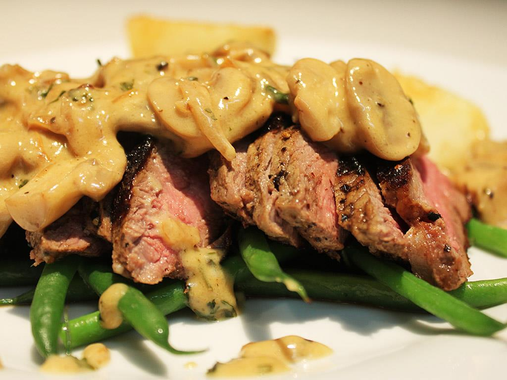 ... creamy mushroom sauce. Accompanied by green beans and potato wedges