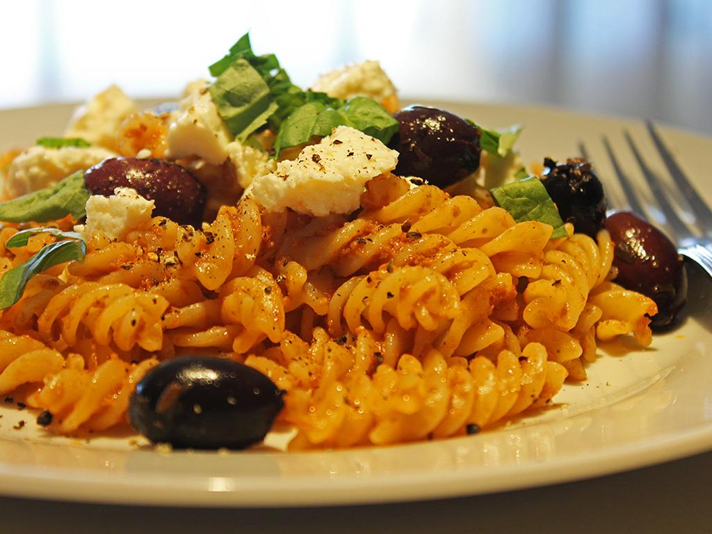 Fusilli with roasted red pepper pesto, topped with black pitted olives ...